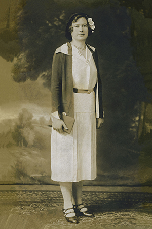 a digitally enhanced version of full-length portrait photo of a woman from the early 20th century