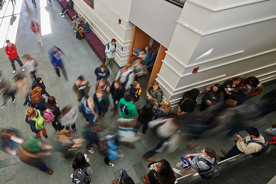 A blur of students walking to and from class inside Laurel Hall.